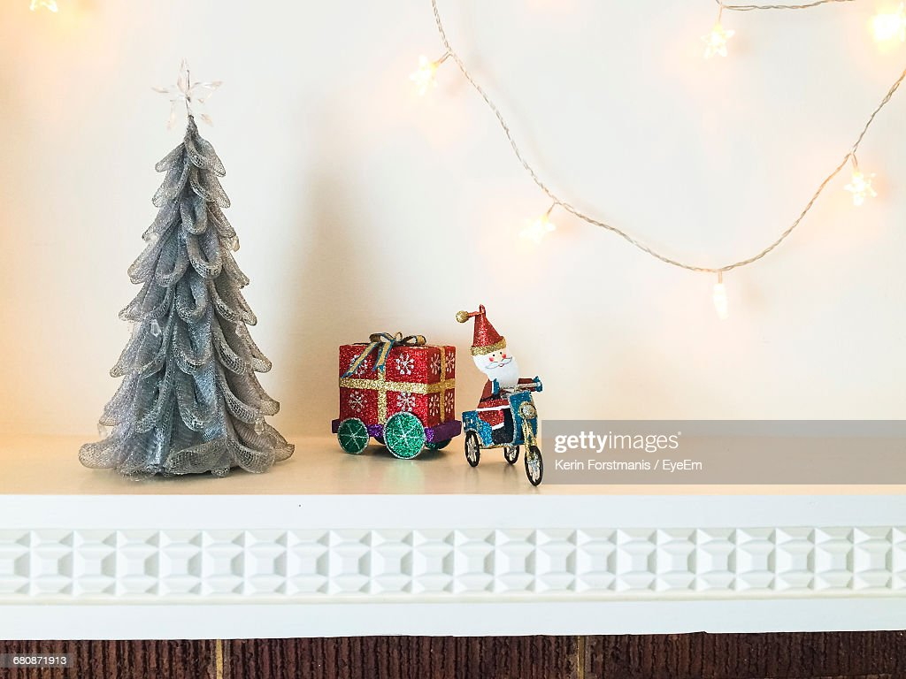 String Lights With Christmas Trees And Santa Claus Figurine On ...