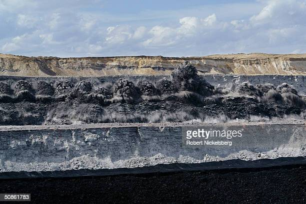 A string of blasts in a rock layer loosens the covering near a 40 foot thick seam of coal at the Buckskin Coal Mine 12 miles north of Gillette...