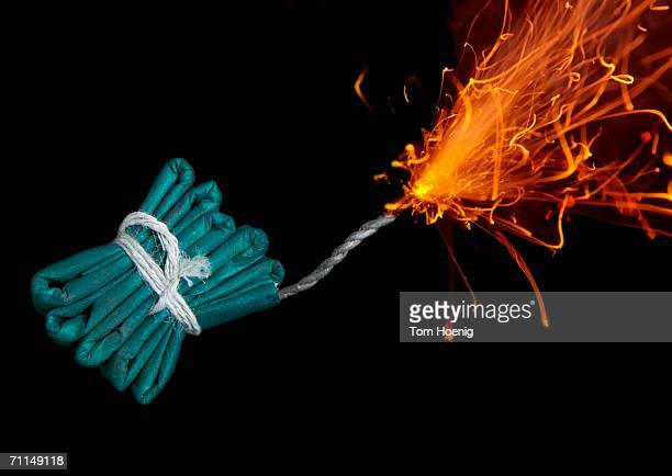 String of firecracker with lit fuse, close-up