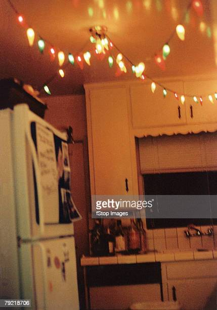 A string of holiday lights in a kitchen