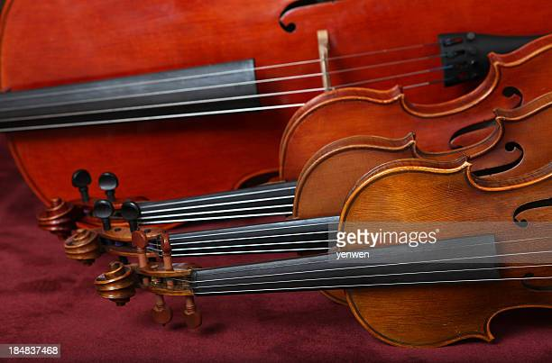 string quartet instruments lying on their side - musical quartet stock photos and pictures
