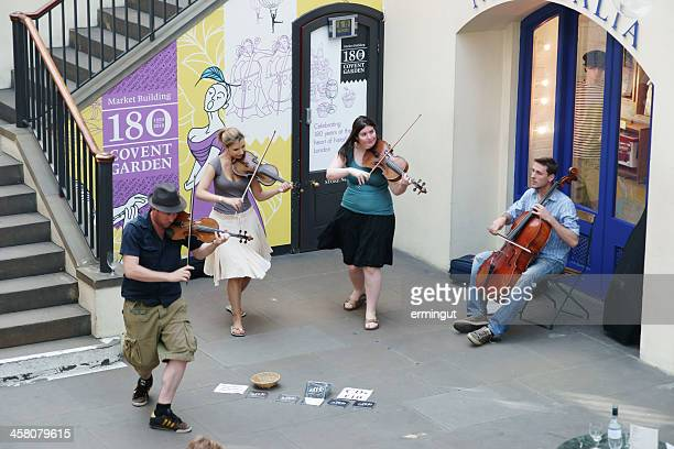 string quartet performing at covent garden - string quartet stock photos and pictures