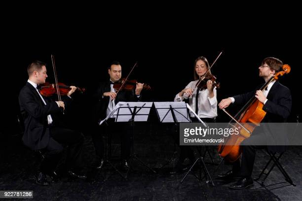 string quartet performing - musical quartet stock photos and pictures