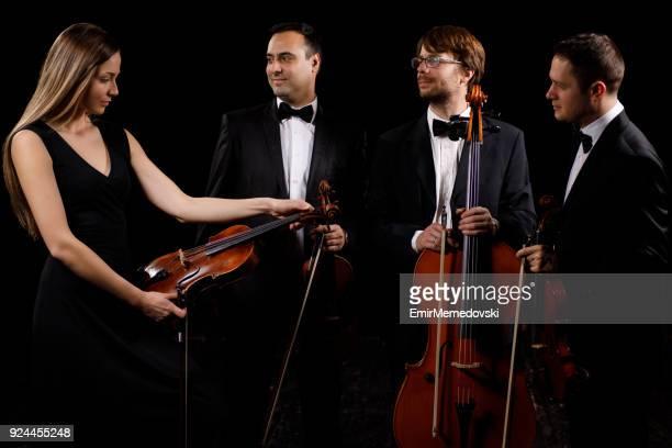 string quartet preparing for concert - string quartet stock photos and pictures