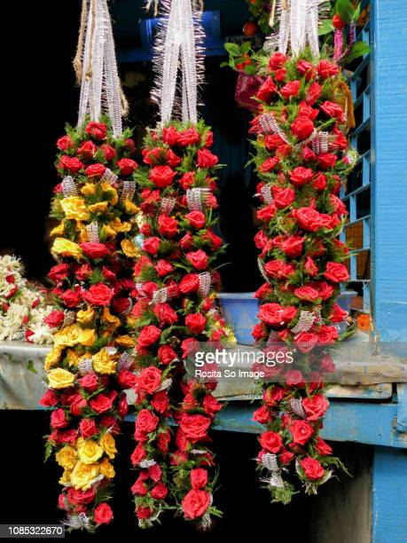 Stringed flowers at Mullik Ghat Flower Market, Kalkota, India