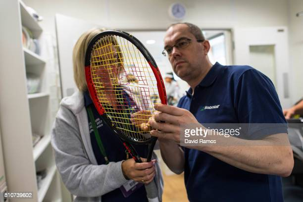 Strings are removed from a racket before it is restrung on day six of the Wimbledon Lawn Tennis Championships at the All England Lawn Tennis and...