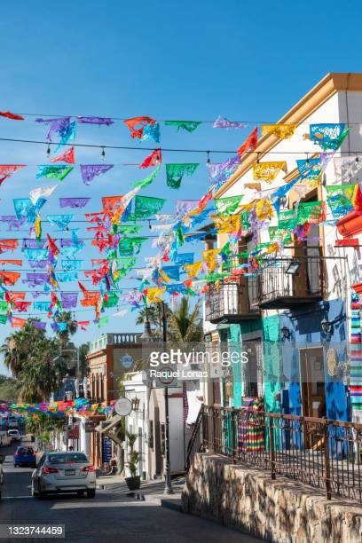 strings of colorful, festive flags over mexican street - メキシコ北部 ストックフォトと画像