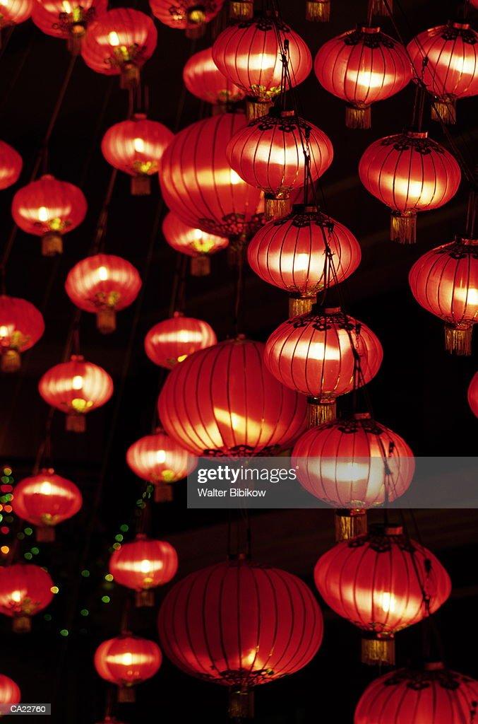 Strings Of Illuminated Red Paper Lanterns Night Close Up Stock Photo