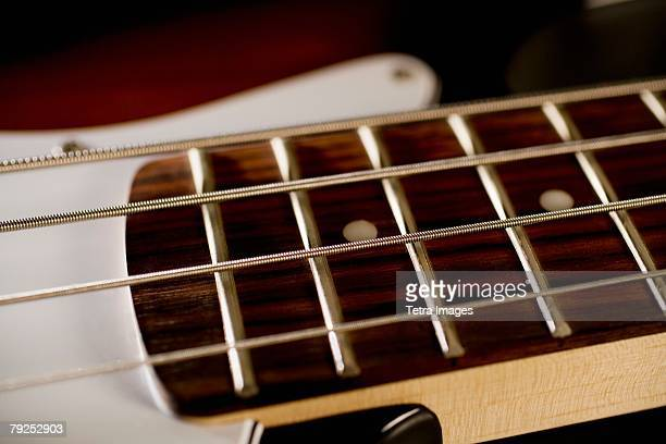 strings on a bass guitar - stringed instrument stock pictures, royalty-free photos & images