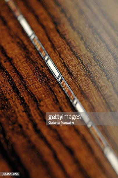 A strip of wooden inlay on the back of an Atkin AA Standard acoustic guitar during a studio shoot for Guitarist Magazine/Future via Getty Images...