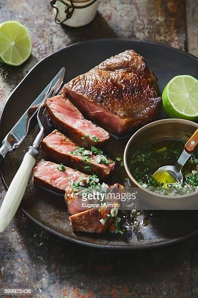 strip steak with chimichurri sauce - チミチュリ・ソース ストックフォトと画像