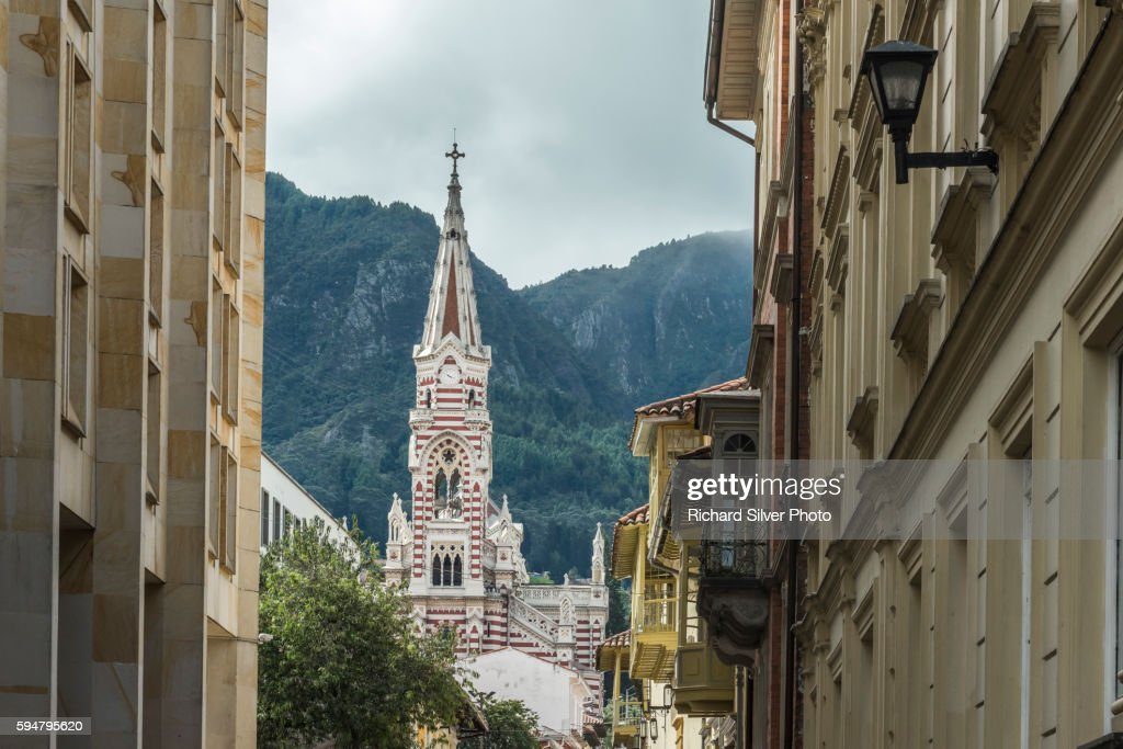 Stripe spire of El Carmen church as veiwed from narrow streets in La Candelaria neighborhood in Bogota, Colombia : Stock Photo