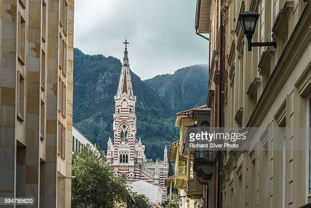 Stripe spire of El Carmen church as veiwed from narrow streets in La Candelaria neighborhood in Bogota, Colombia