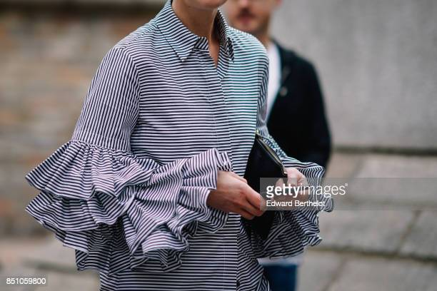 A striped black and white ruffled top outside Preen by Thornton Bregazzi during London Fashion Week September 2017 on September 17 2017 in London...