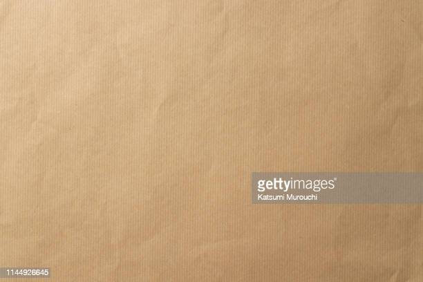 striped brown paper texture background - brown paper stock pictures, royalty-free photos & images