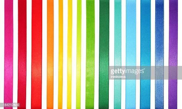 a striped colored spectrum of rainbow colors - ribbon stock pictures, royalty-free photos & images