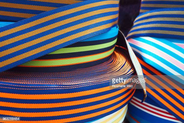 striped colorful woven ribbons - ribbon sewing item stock pictures, royalty-free photos & images