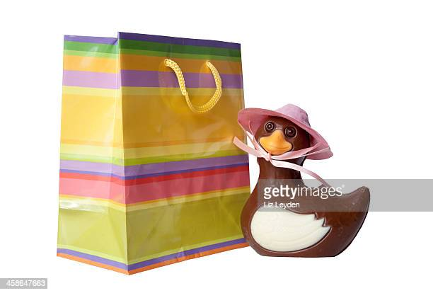 Striped gift bag with chocolate duck: Easter novelty present.