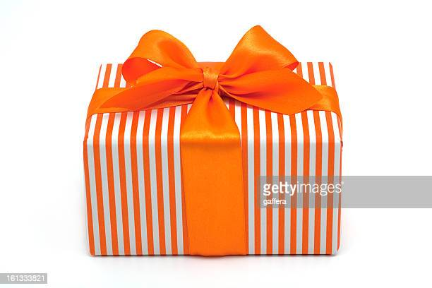 striped gift box with orange ribbon