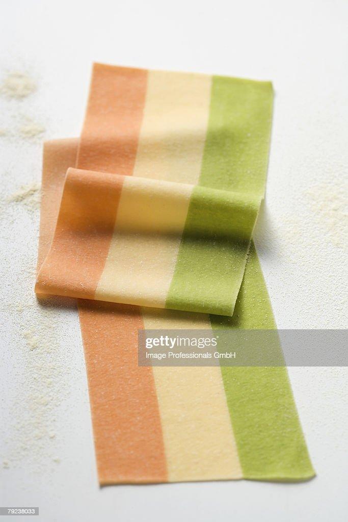 Striped pasta dough in three colours : Stock Photo