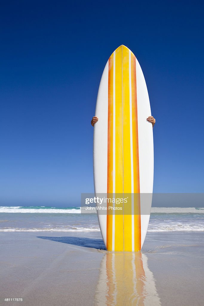 Striped Retro Surfboard On A Beach Australia Stock Photo