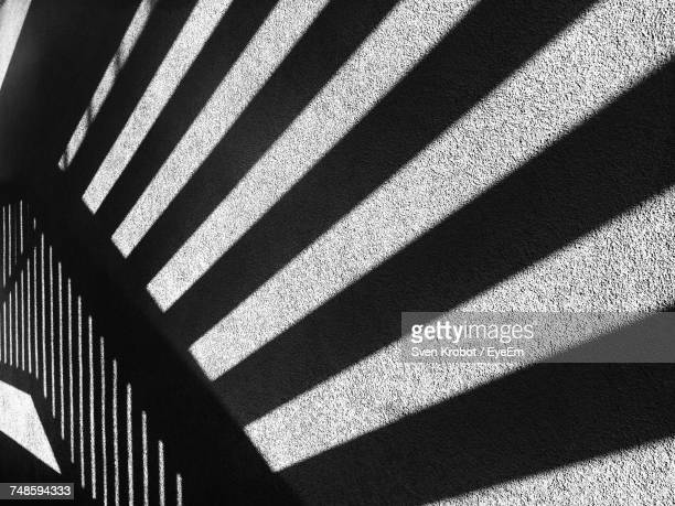 Striped Shadow On Concrete Wall
