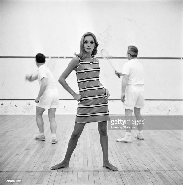Striped shift dress on the squash court, UK, 8th May 1967.