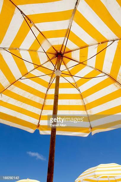 Striped umbrella under blue sky