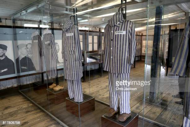 Striped uniforms on display within the Stutthof concentration camp during an official visit of the Duke and Duchess of Cambridge to Poland and...