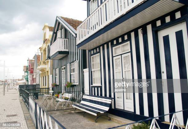 striped wooden house in beach - aveiro district stock pictures, royalty-free photos & images