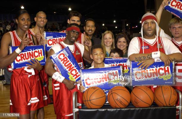 Stripes team poses after winning the game Lisa Leslie Shane Battier Sean 'P Diddy' Combs Redman and Nick Carter