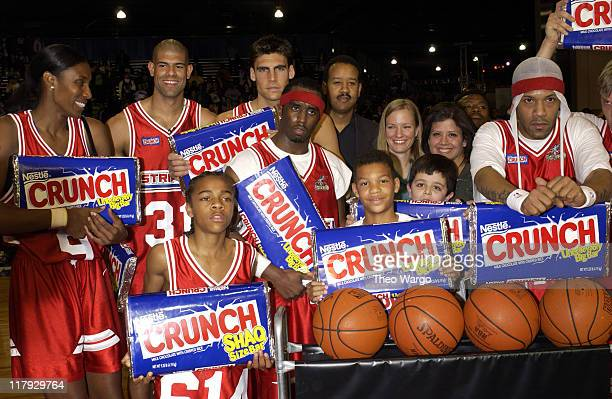Stripes team poses after winning the game Lisa Leslie Shane Battier Lil' Bow Wow Wally Szczerbiak Sean P Diddy Combs and Redman