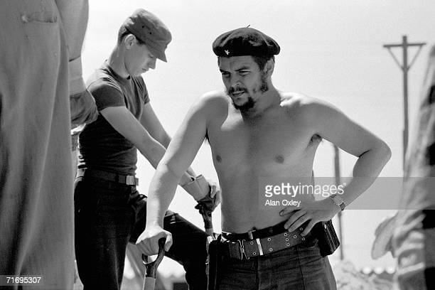 Stripped to the waist Ernesto Che Guevara who waged guerrilla warfare with the Castro brothers helps workers on a low cost housing project near...