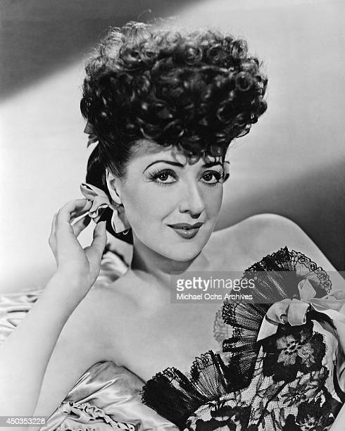 Stripper actress and author Gypsy Rose Lee poses for a publicity photo for the film 'Belle of the Yukon' in 1944