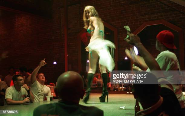 Stripper dances for a customer at the Deja Vu Showgirls Club on Bourbon Street in the French Quarter of New Orleans, 21 September 2005. A very small...
