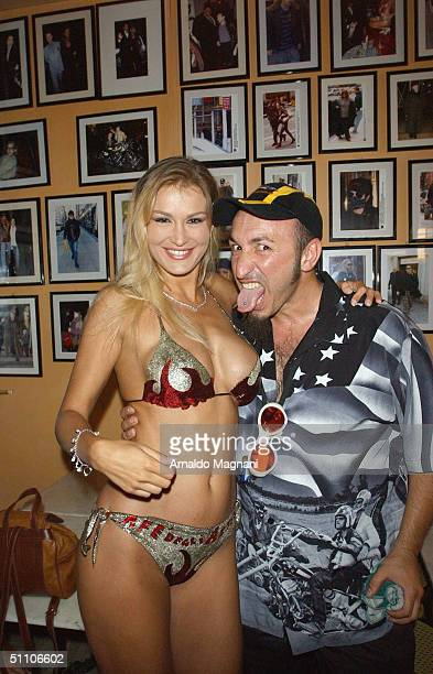 Stripper Eva Henger appears at the 10th Bikers Bikini Benefit at Cafe degli Artisti July 18, 2004 in Cesenatico, Italy.