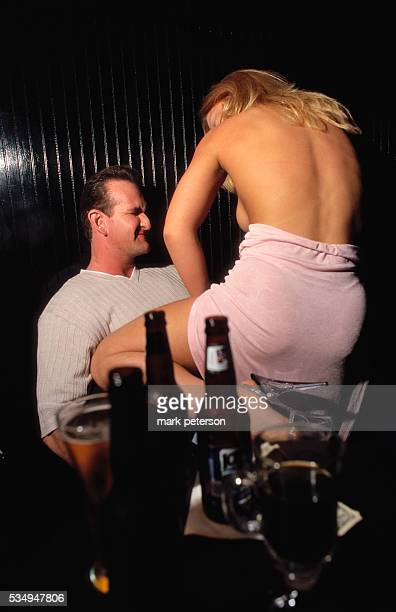 A stripper performs a lap dance for a customer at the Gentlemen's Club