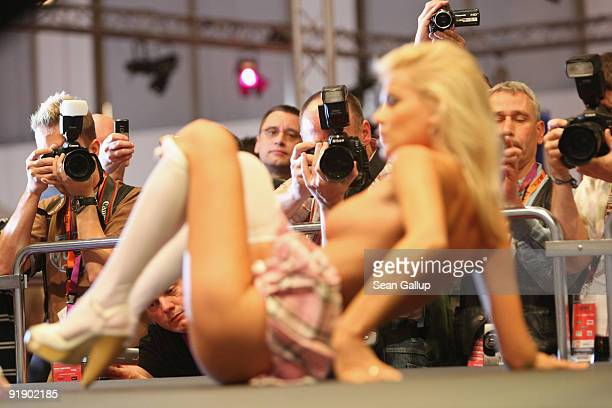 A stripper performs at the Venus erotic trade fair during the press and industry professionals' day on October 15 2009 in Berlin Germany Venus will...