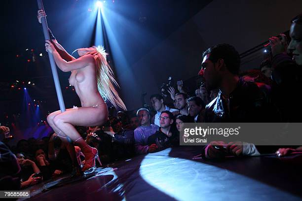 A stripper pole dances in Israel's first sex festival on February 05 2008 in Tel Aviv Israel The festival includes strip shows innovative sex toy...