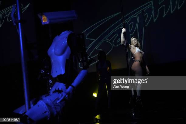 A 'stripper robot' performs alongside with a pole dancer during a debut of the first robotic erotic dancers in the world at Sapphire Las Vegas...