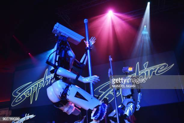 Stripper robots perform at the Sapphire Gentlemen's Club on the sidelines of CES 2018 in Las Vegas on January 8 2018 / AFP PHOTO / MANDEL NGAN