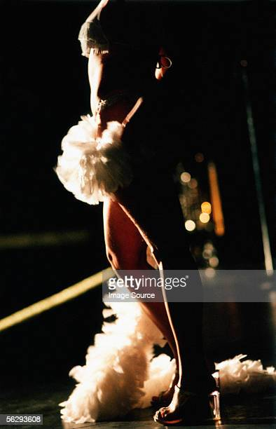Stripper with a feather boa