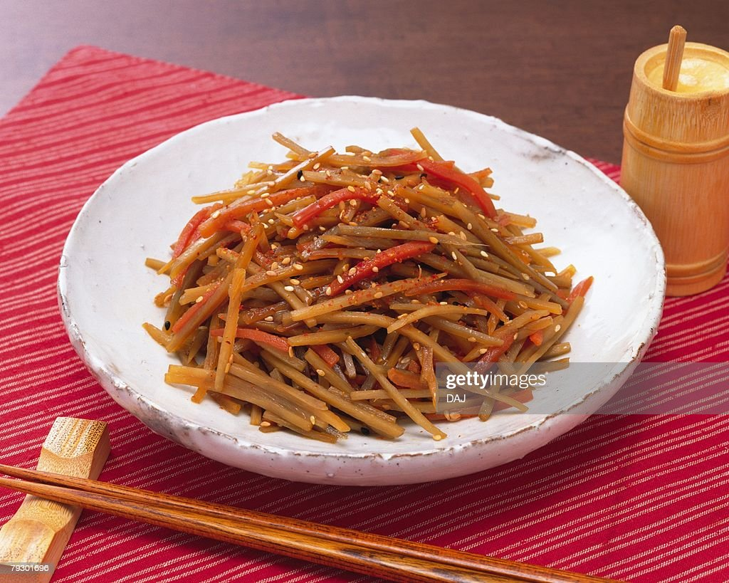 Strips of burdock and carrot cooked in soy sauce, high angle view : Foto de stock
