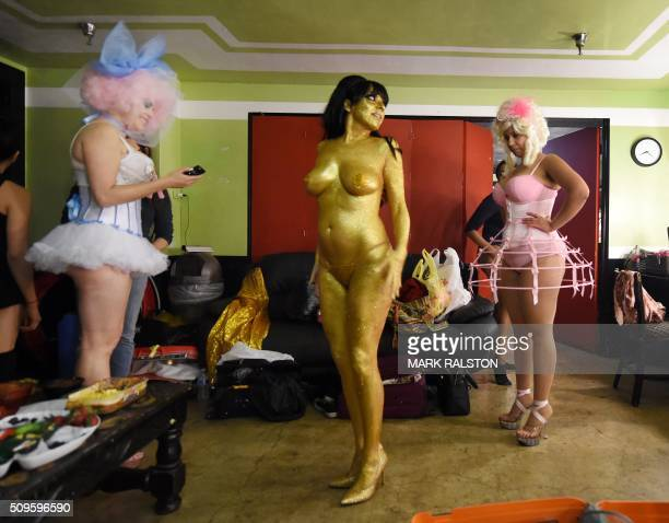 TOPSHOT Striptease artist Moana Santana receives a coat of gold makeup backstage before the Lucha Va Voom's 'Crazy in Love' show at the Mayan Theatre...