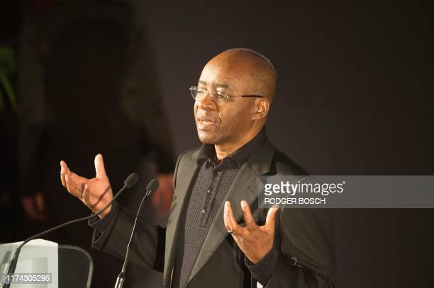 Strive Masiyiwa a Londonbased Zimbabwean telecoms businessman entrepreneur and philanthropist speaks the Desmond Tutu Peace lecture which coincides...