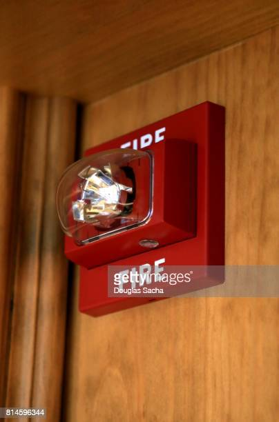 Strobe light fire alarm for the deaf hanging on a upper wall