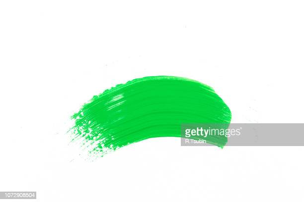 stroke of the paint brush on white paper - brush stroke stock pictures, royalty-free photos & images