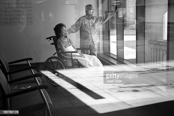 CONTENT] Stroke patient comforted by companion in the common area of a rehab hospital