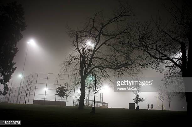 stroll in the fog - all weather running track stock pictures, royalty-free photos & images
