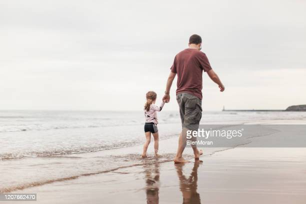 a stroll on the beach - beach stock pictures, royalty-free photos & images
